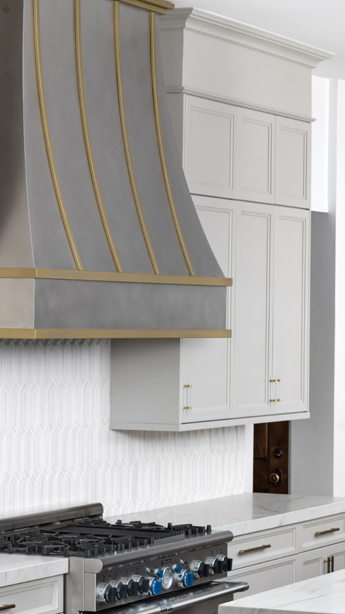 Large stainless steel and gold range hood (92)