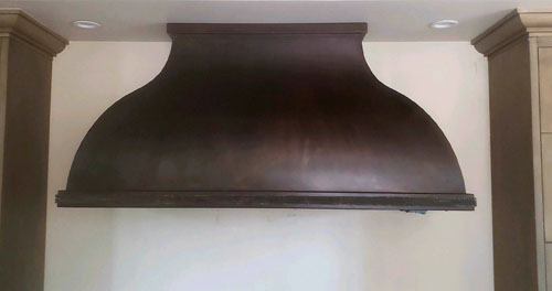 Large stainless triple stacked range hood (94)