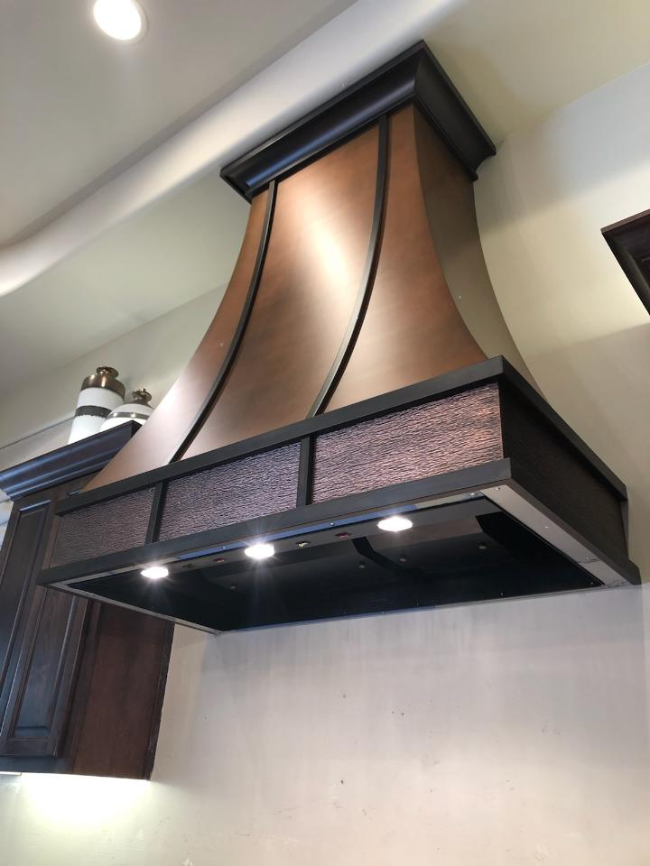 Copper finish and texture range hood (104)